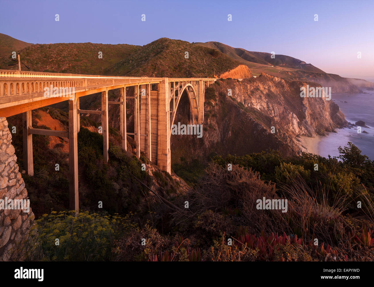 Bixby Bridge Pacific Coast Highway Big Sur California. Bixby Creek Canyon Bridge with coastline light streaks of - Stock Image
