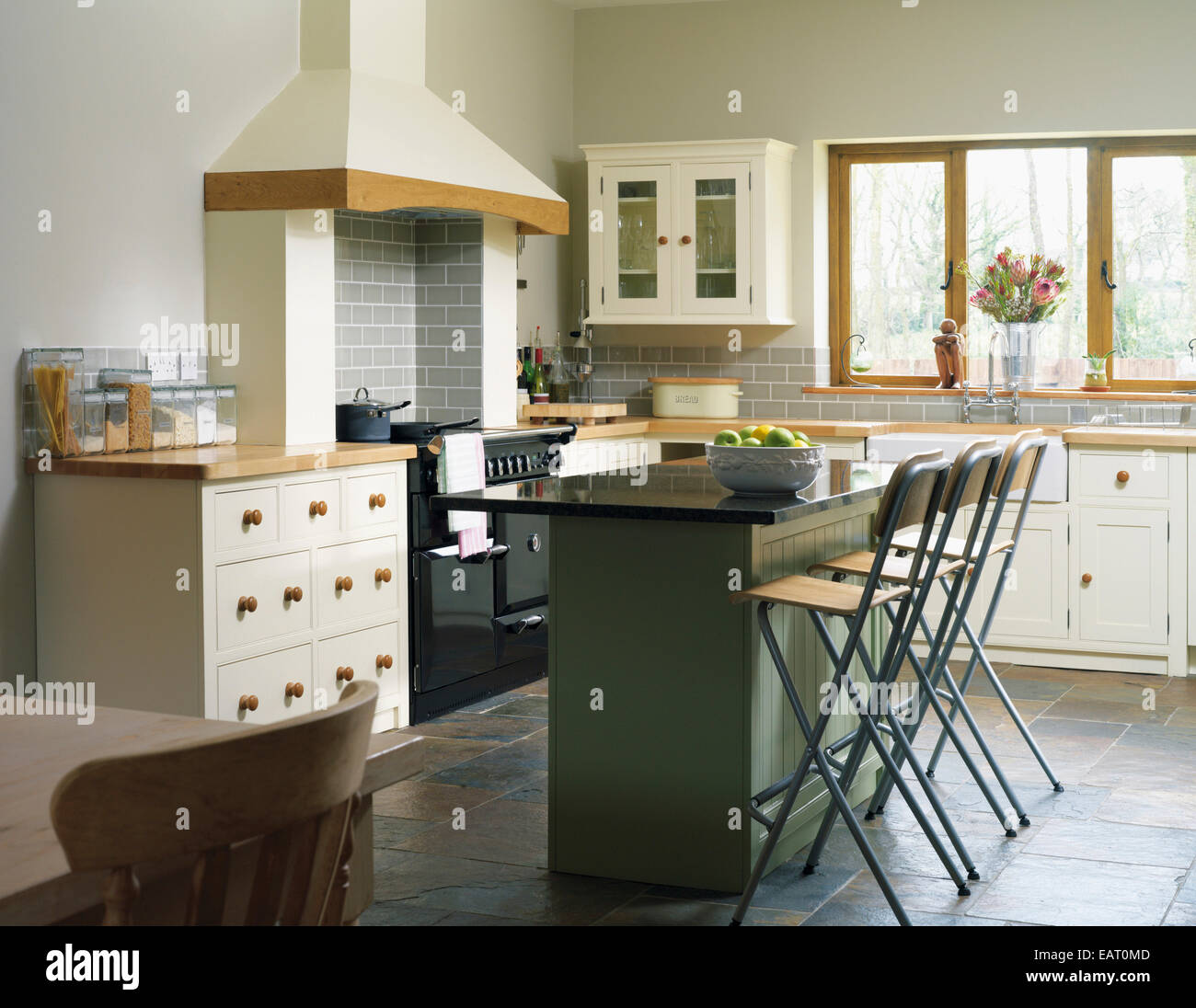 Central Island Breakfast Bar In Kitchen With Fitted Units Stock