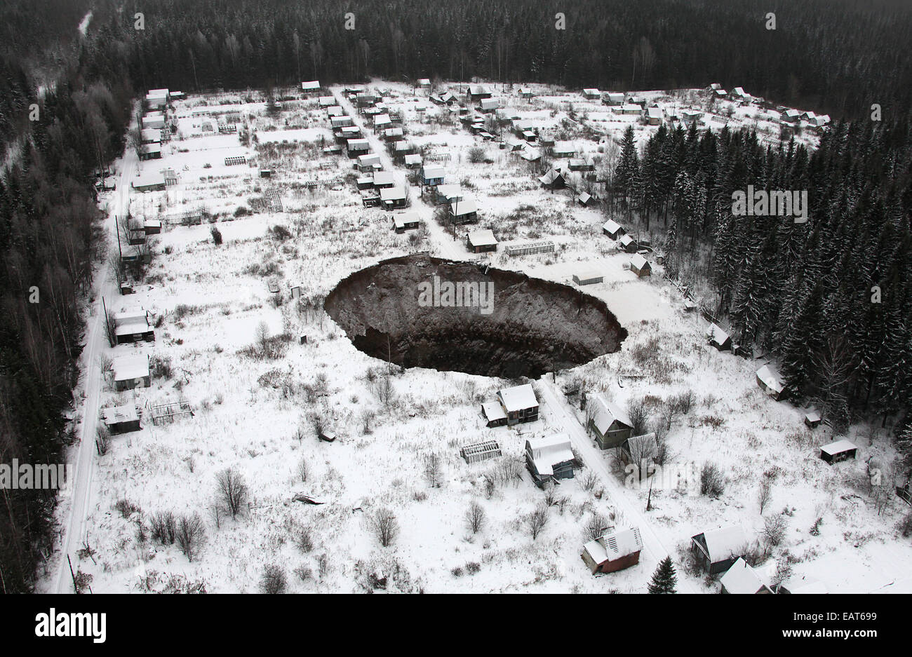 Perm Territory, Russia. 20th Nov, 2014. A view of a sinkhole stretching 20 by 30 meters at the Solikamsk-2 mine. Stock Photo