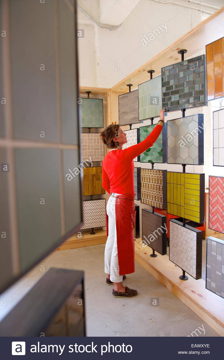 Ceramics tiles stock photos ceramics tiles stock images alamy a heath ceramics employee arranges tiles for the window display stock image dailygadgetfo Images
