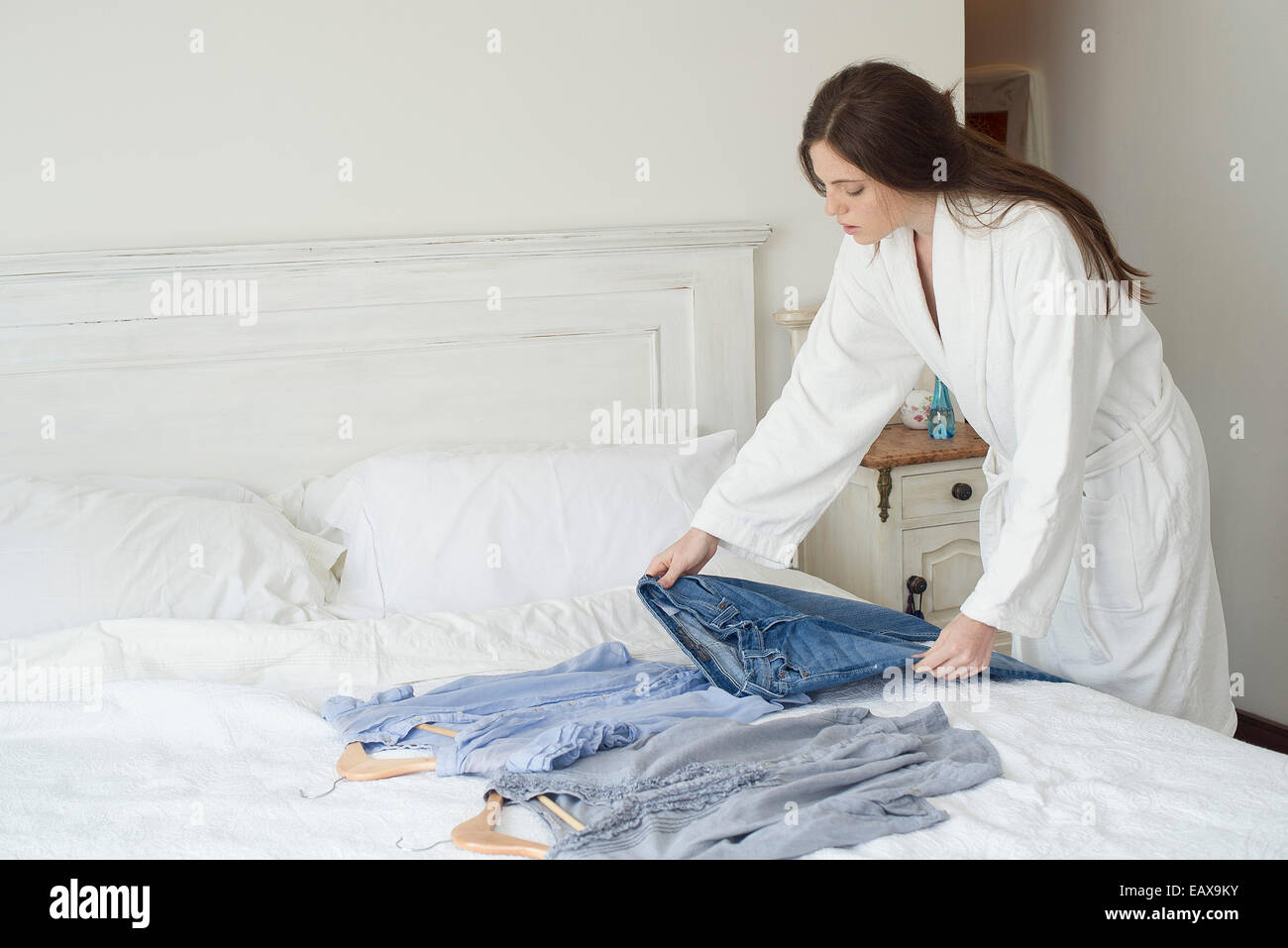 Woman choosing outfit to wear - Stock Image