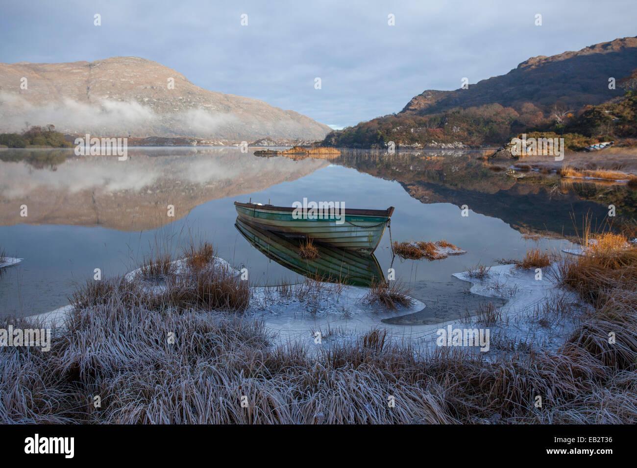 Frosty fishing boat on the shore of Upper Lake, Killarney National Park, County Kerry, Ireland. - Stock Image