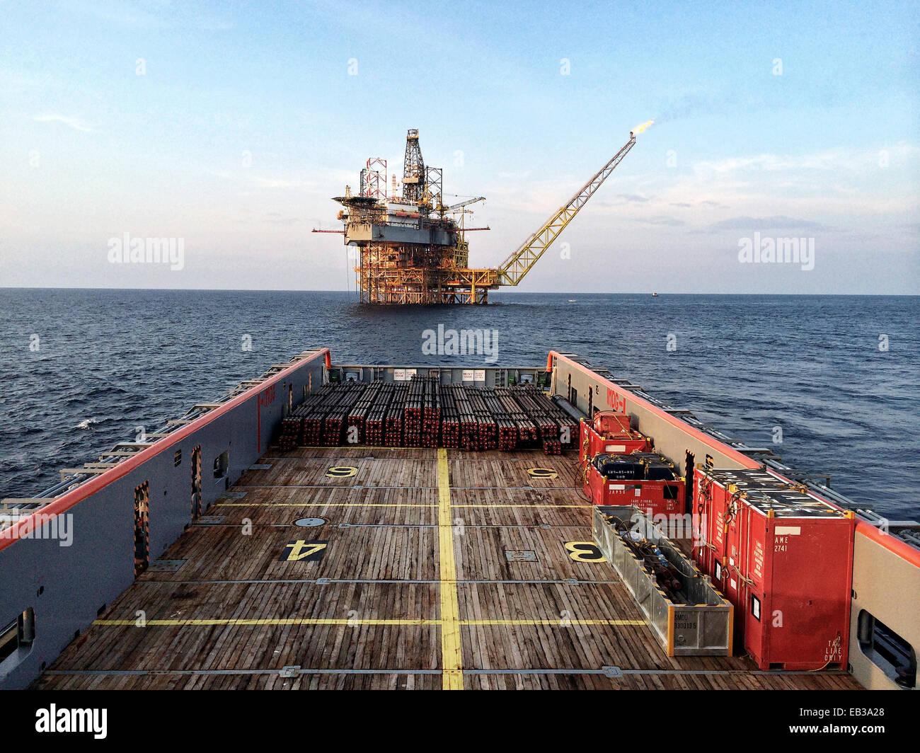 Oil platform seen from main deck of platform supply vessel - Stock Image