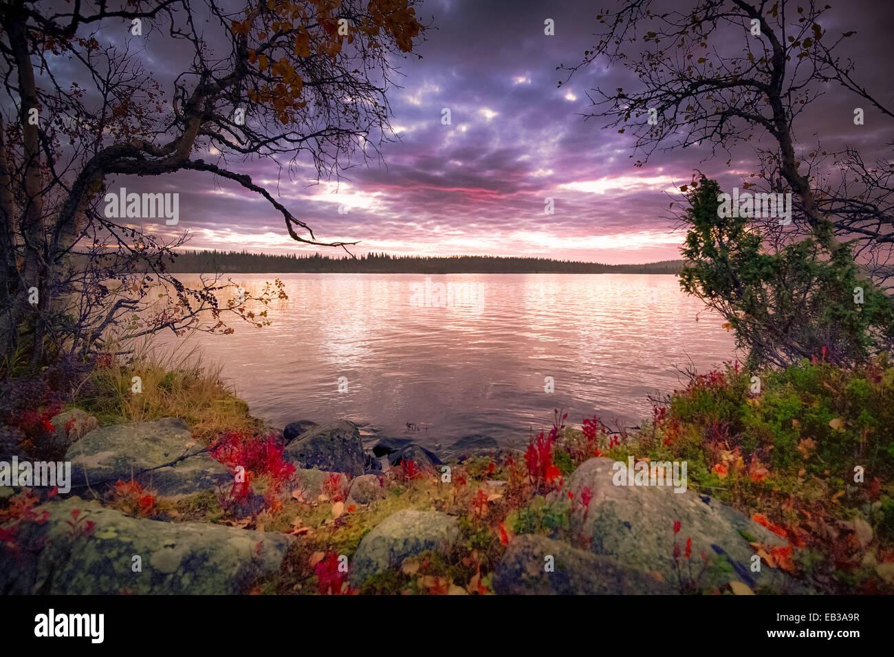 View of lake at dusk - Stock Image