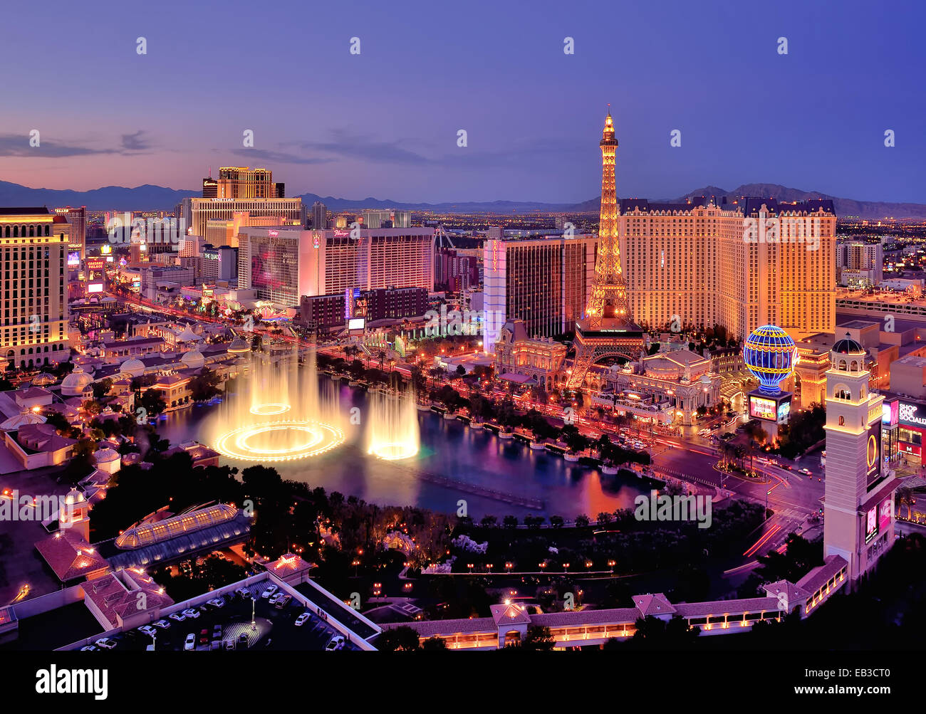 City skyline at night with Bellagio Hotel water fountains, Las Vegas, Nevada, America, USA - Stock Image