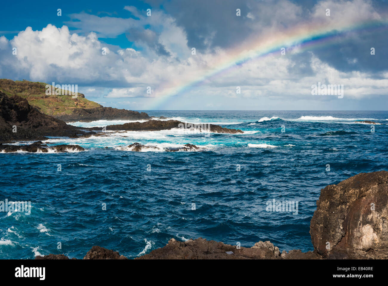 choppy-seas-and-rainbow-in-the-port-of-garachico-renowned-for-having-EB40RE.jpg