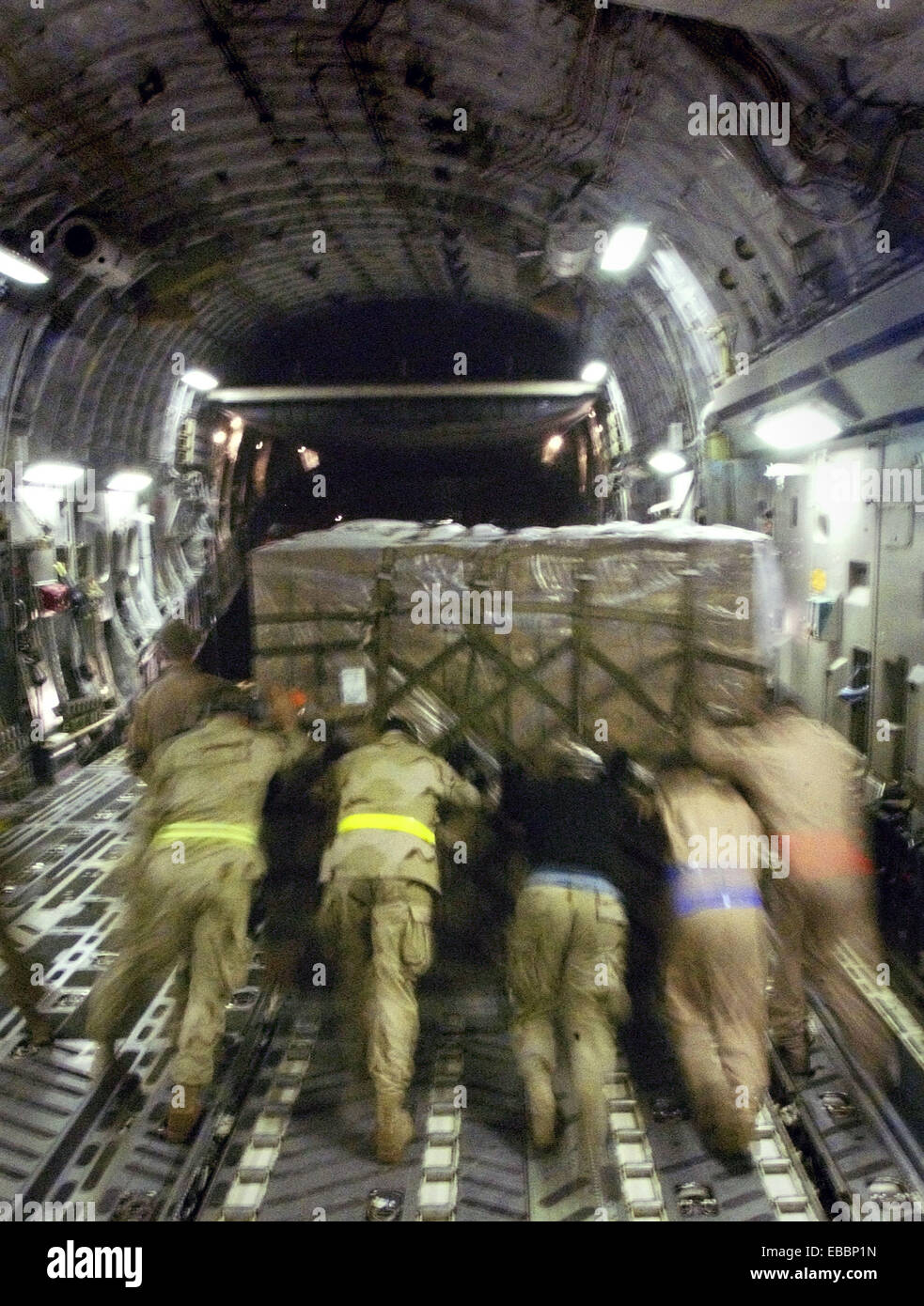 CHAKLALA AIR BASE, Pakistan -- Airman offload relief supplies from a C-17 Globemaster III here Oct. 17. The Airmen, - Stock Image