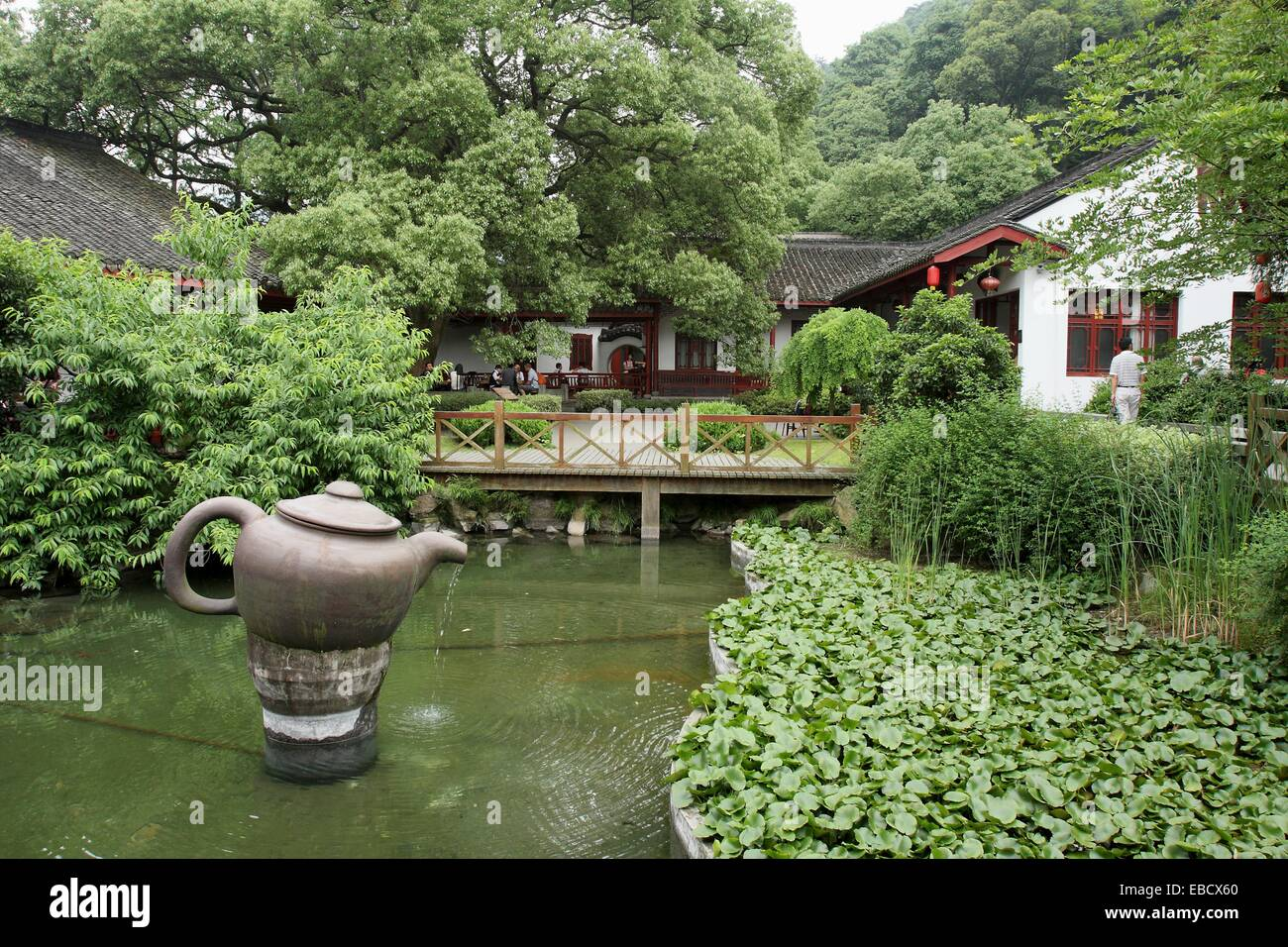 Chinese garden decorate with big teapot in meddle of the pond, china ...