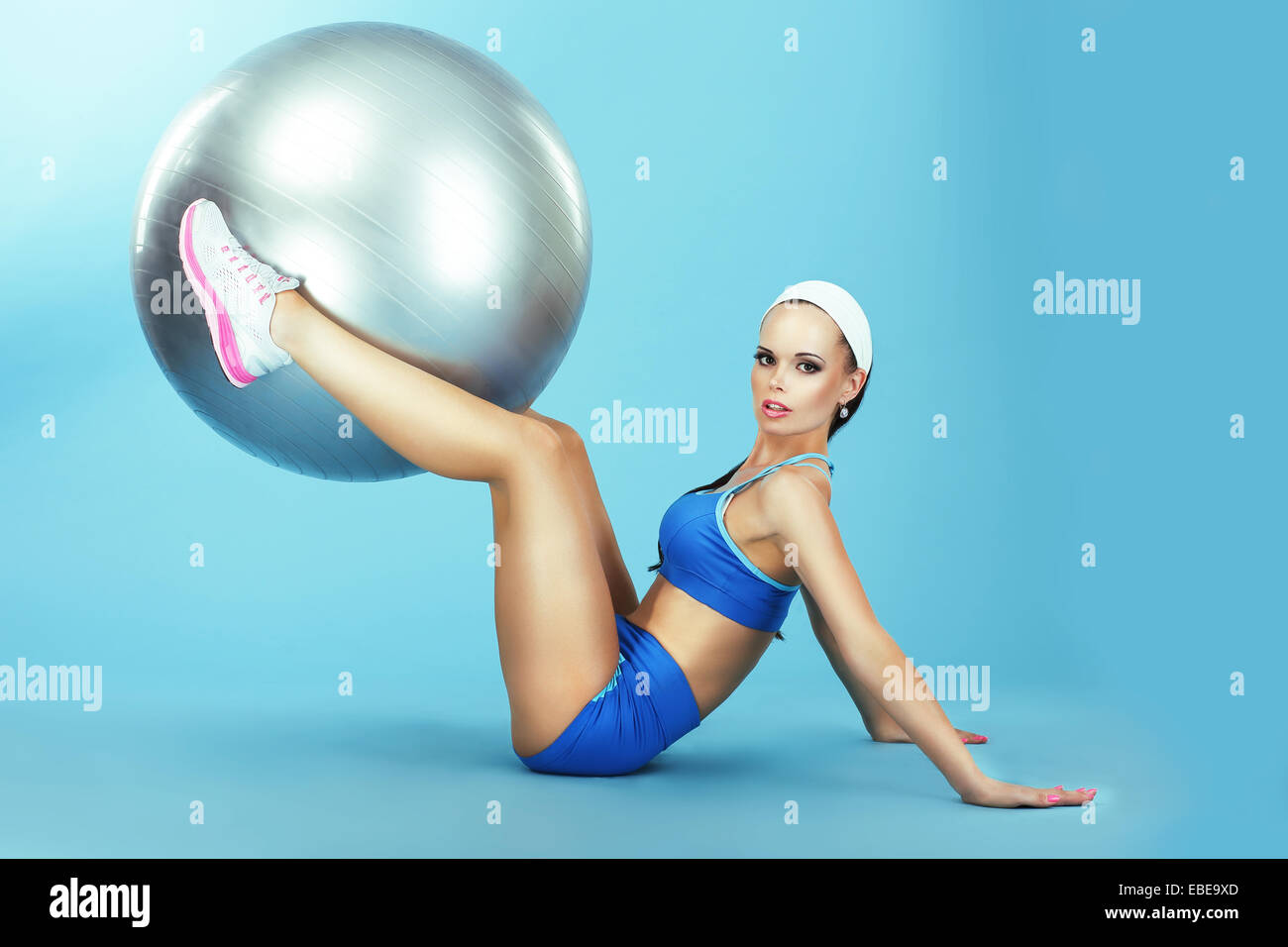 Training. Athletics. Woman in Sportswear with Fitness Ball - Stock Image