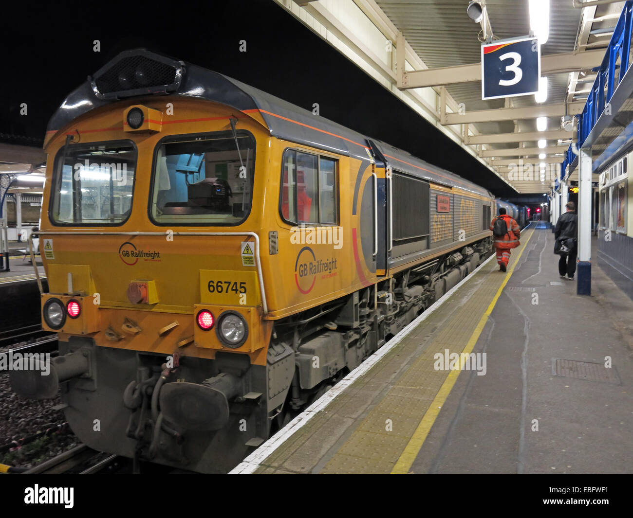 platform,platforms,train,trains,lit,lights,Battersea,tube,tube train,passenger,passengers,guard,accident,England,UK,GB,Great Britain,Clapham,Junction,Railway,station,at Night,rail,rails,lines,carriage,carriages,freight,engine,freight engine,66745,55745,yellow,GBRf,FGW No.153361,Gotonysmith,tube trains,mind,the,gap,mind the gap,dusk,nightshot,nightshot,Buy Pictures of,Buy Images Of