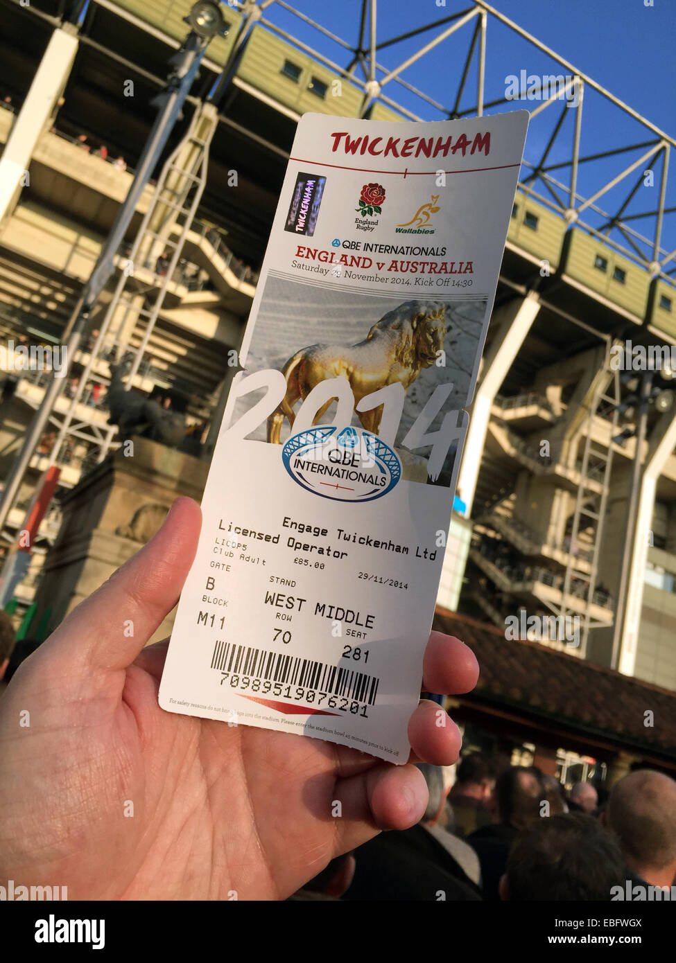 team,sport,stadium,programme,program,hospitality,stadia,stadium,ticket,hospitality,visit,trip,business,home,of,the,RFU,championship,champion,UK,GB,Holding,an,entrance,ticket,up,at,hand,barcode,security,features,fraud,counter,counterfraud,stubhub,stub,hub,ticketmaster,secondhand,tickets,at,inflated,gotonysmith,qbe,6nations,6,nations,six,tournament,sporting,venue,champions,united,Kingdom,Great,Britain,second,hand,illegal,prices,expensive,counterfeit,engvAus,England,Australia,stand,in,background,Buy Pictures of,Buy Images Of