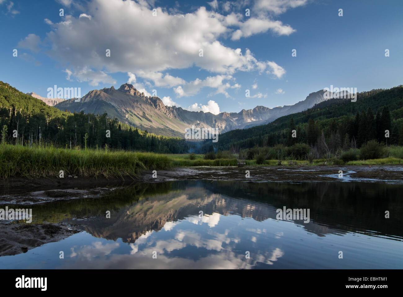 Majestic San Juan Mountains beautifully reflected in a pond in the Colorado Rockies Stock Photo