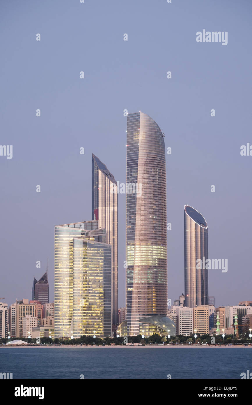 Skyline of modern buildings along Corniche waterfront in Abu Dhabi United Arab Emirates - Stock Image