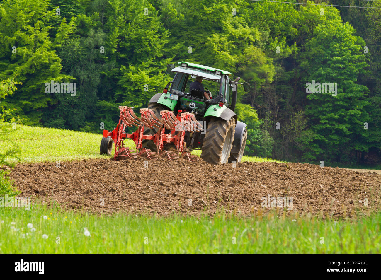 farmer plowing a meadow, Germany, Bavaria - Stock Image