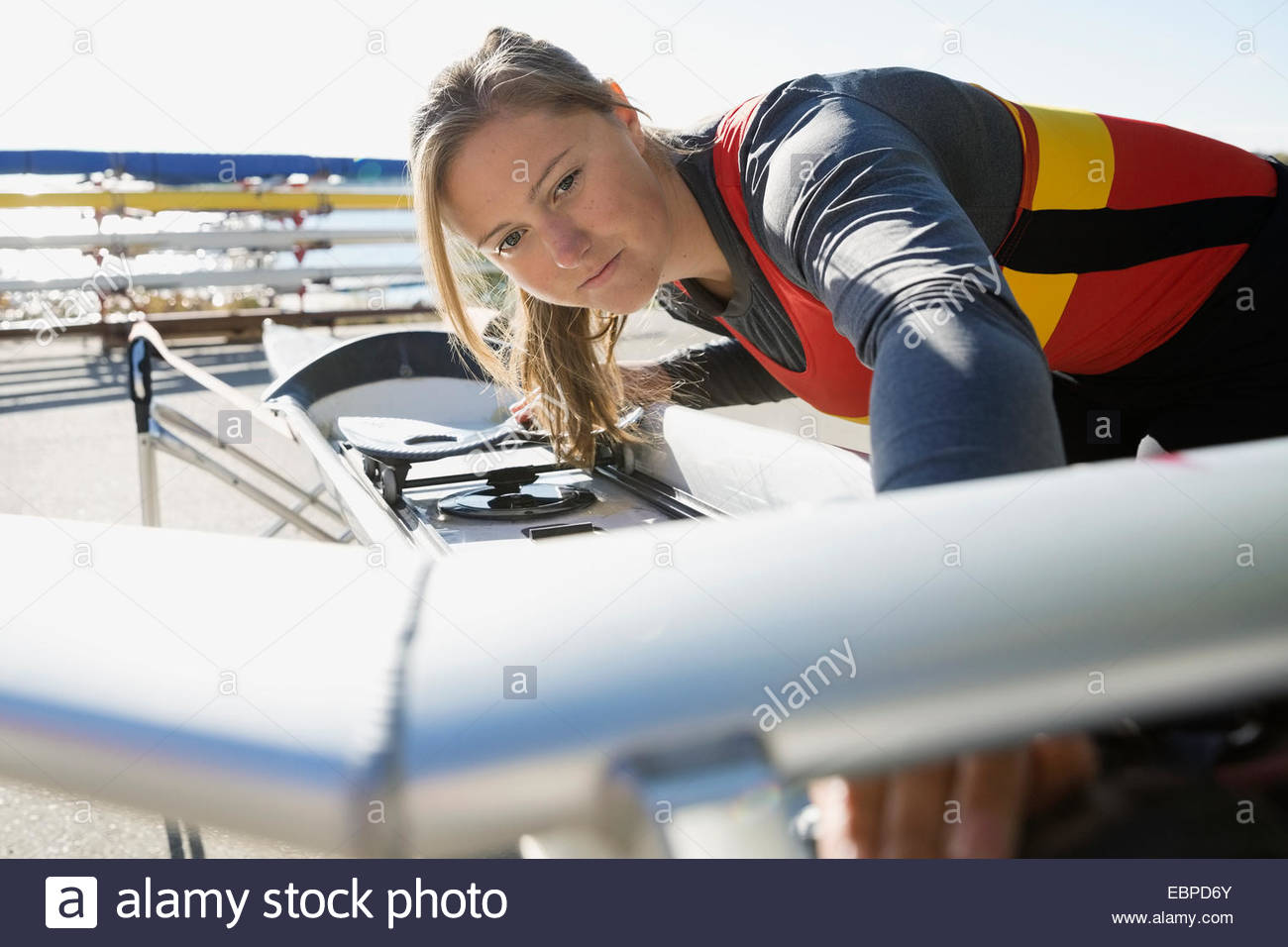 Rower examining scull - Stock Image