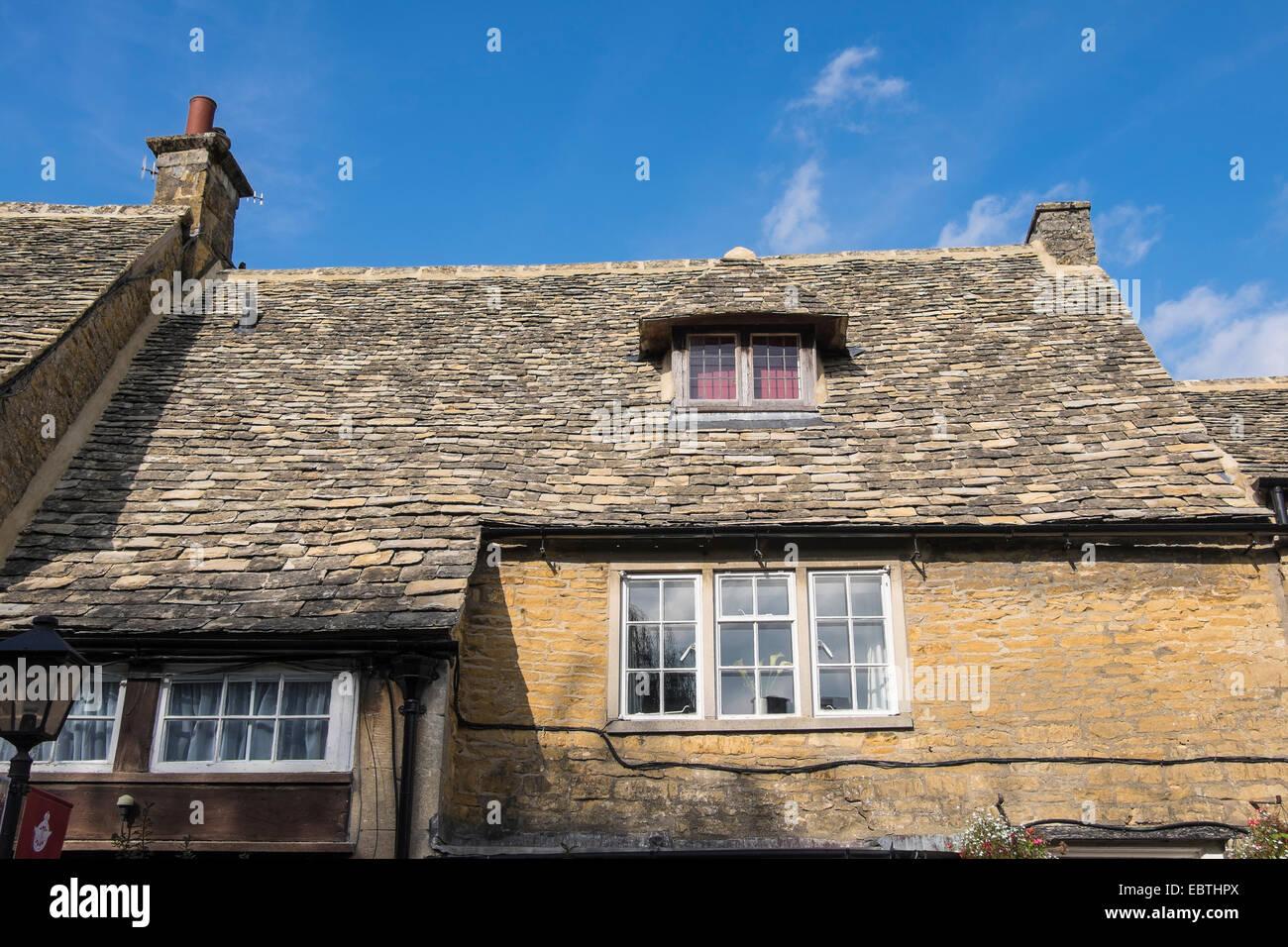 cotswold-stone-roof-tiles-dormer-window-bourton-on-the-water-cotswolds-EBTHPX.jpg