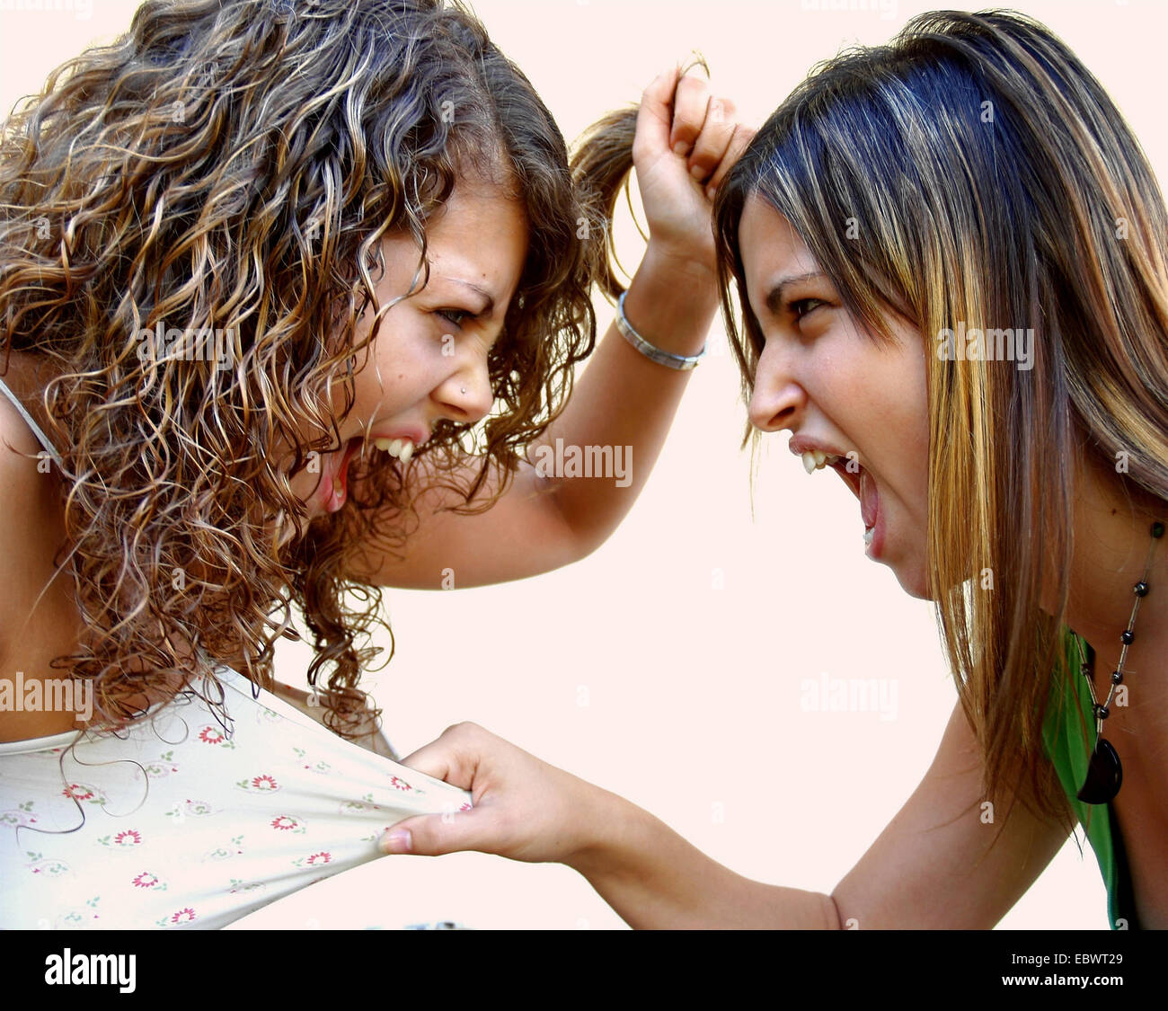 two young women face to face turn violent - Stock Image