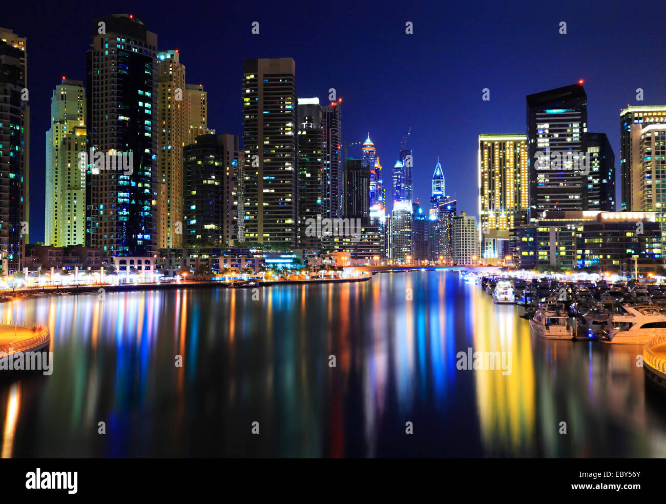 Dubai Marina at night. Reflections of skyscrapers in water - Stock Image