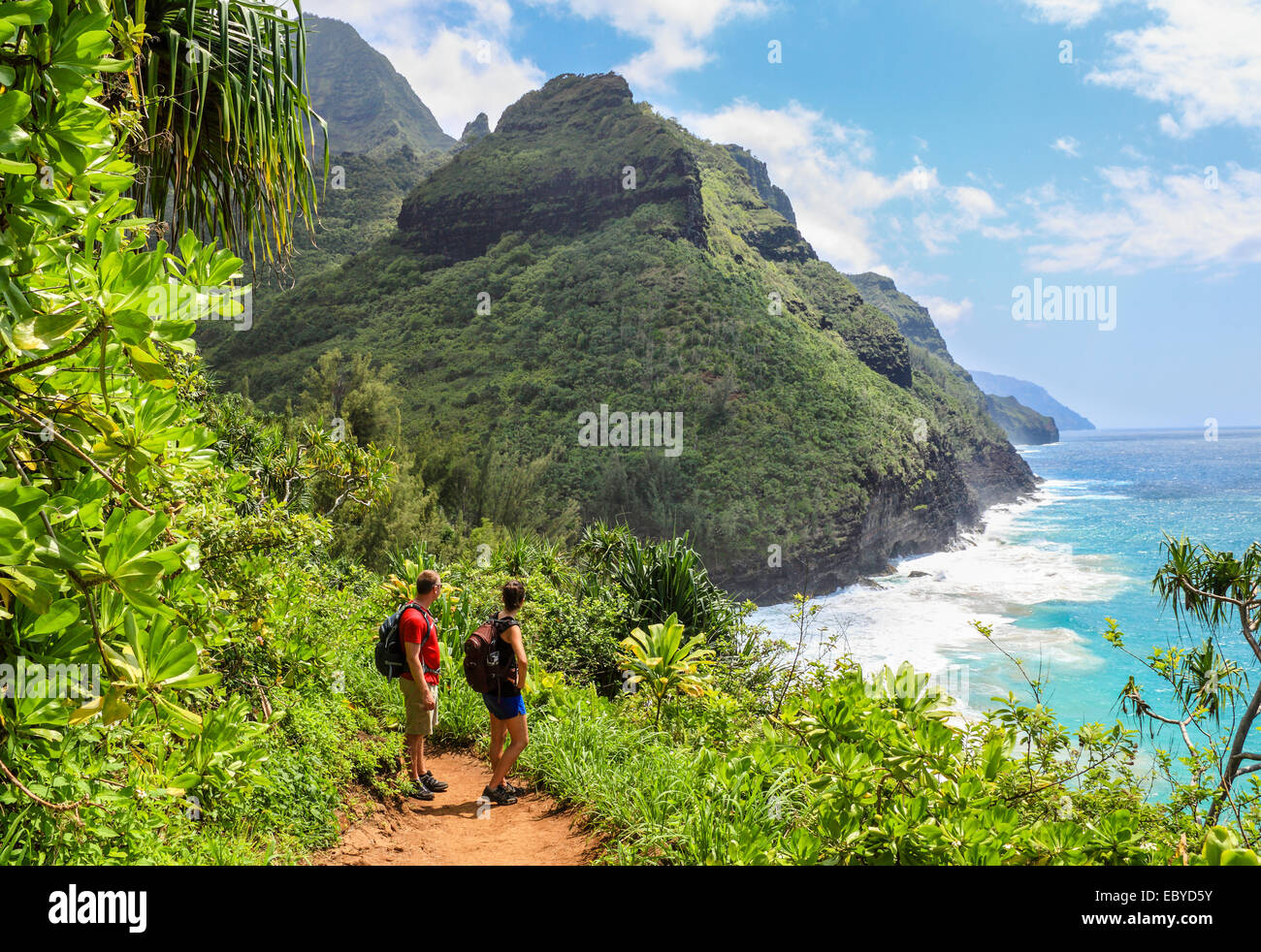 Hikers on the Kalalau Trail on Kauai Stock Photo