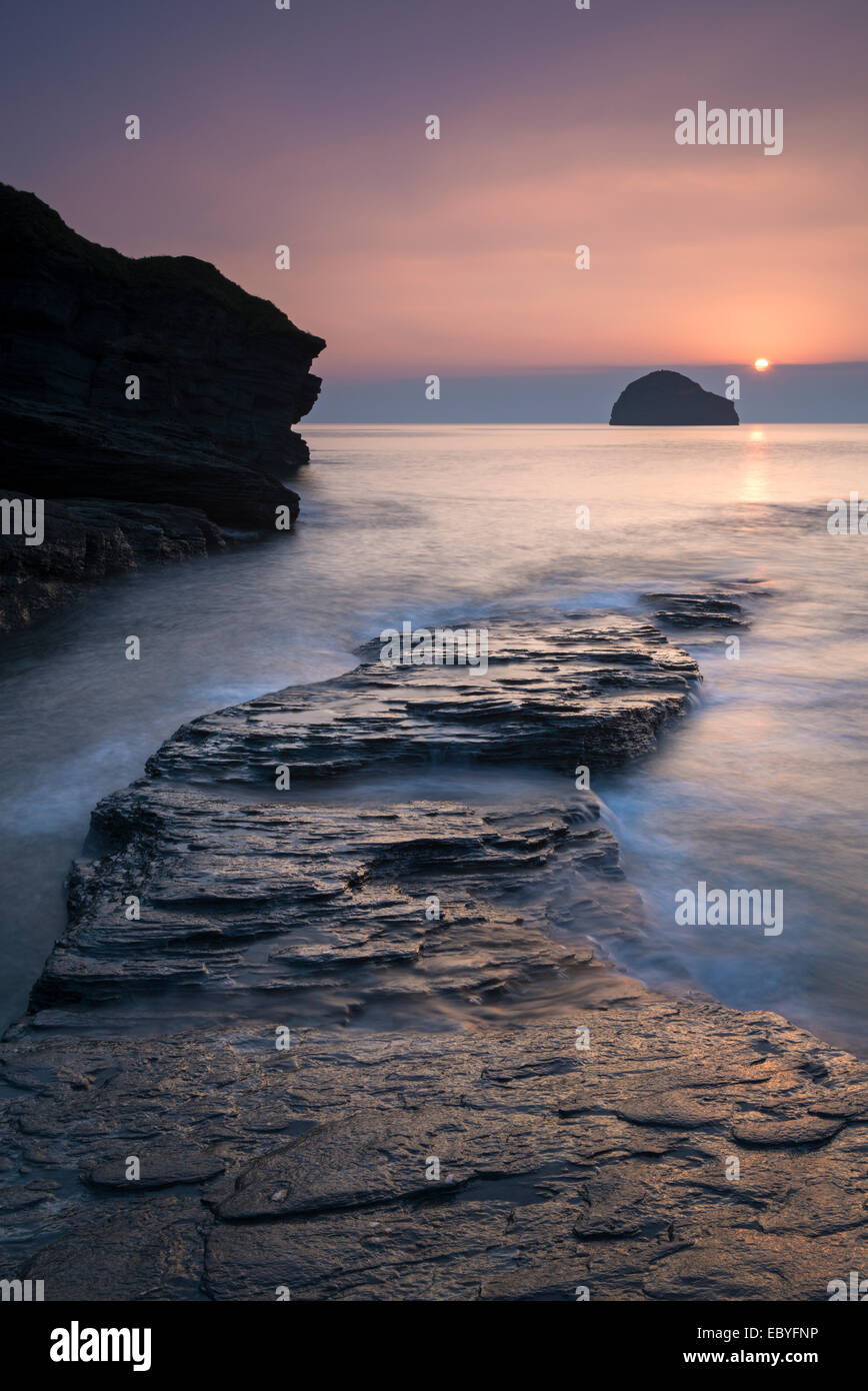 Sunset over Gull Rock from Trebarwith Strand, Cornwall, England. Autumn (September) 2014. - Stock Image