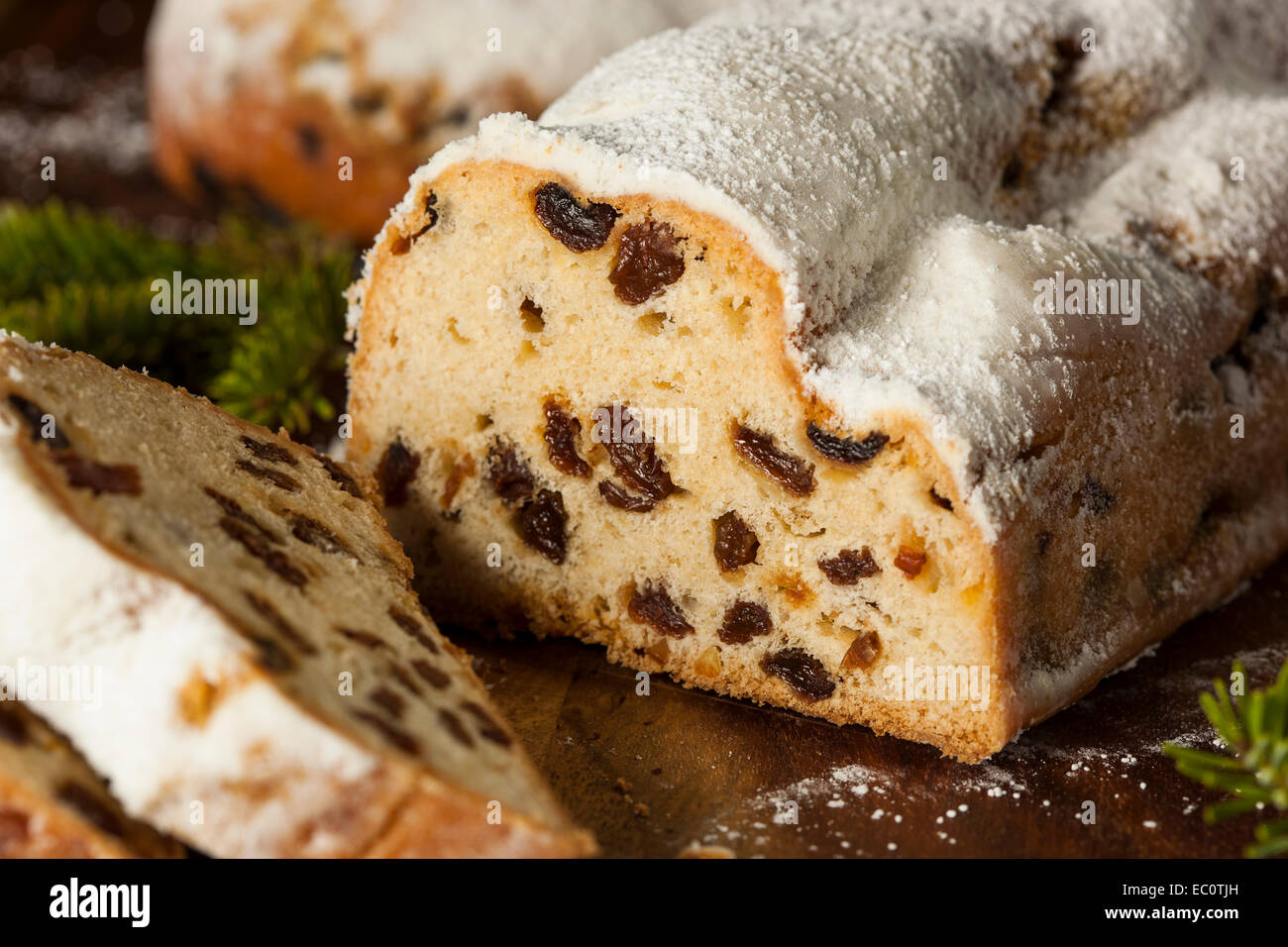 Festive Christmas German Stollen Bread with Powdered Sugar - Stock Image