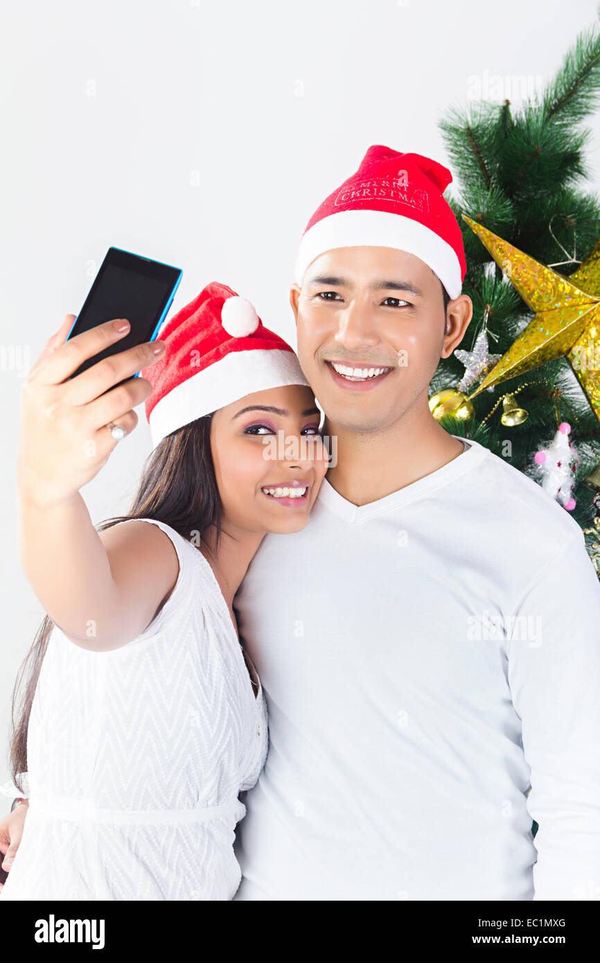 indian couple Christmas Festival phone Photography Stock Photo ...