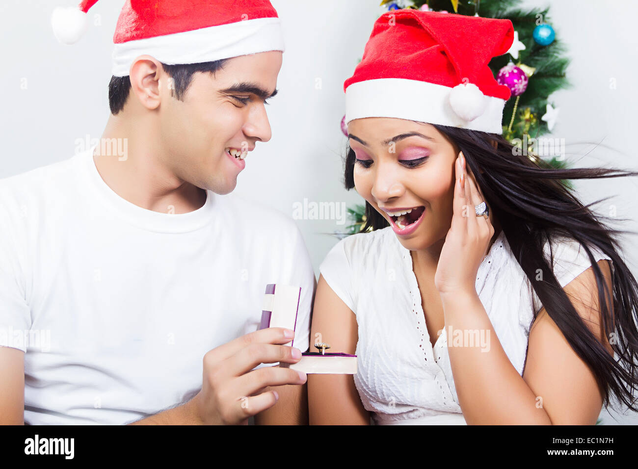 indian couple Christmas Festival surprise gift Stock Photo: 76255973 ...