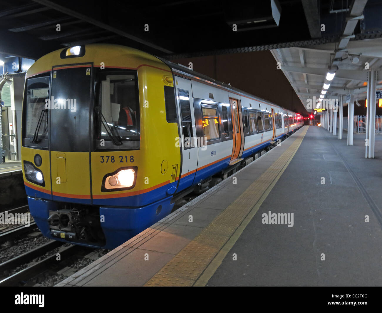 platform,platforms,train,trains,lit,lights,Battersea,tube,tube train,passenger,passengers,guard,accident,England,UK,GB,Great Britain,Clapham,Junction,Railway,station,at Night,rail,rails,lines,carriage,carriages,Gotonysmith,tube trains,mind,the,gap,mind the gap,376215,378218,dusk,nightshot,nightshot,Buy Pictures of,Buy Images Of