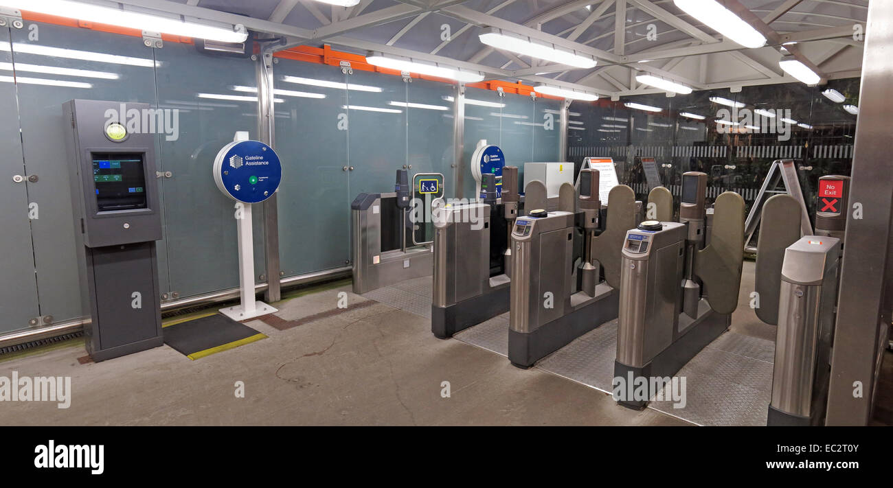 Wide,shot,of,Olympia,exhibition,centre,Tube,Station,London,overground,entrance,Oyster,card,gates,machines,metro,control,automated,automatic,system,ticket,transport,travel,tube,turnstiles,pass,payment,travel,traveler,capital,fare,fares,subway,transportation,gotonysmith,tube,station,entrance,gates,London,panorama,tube station,Olympia Exhibition,help point,well lit,lighting,night,at night,Buy Pictures of,Buy Images Of