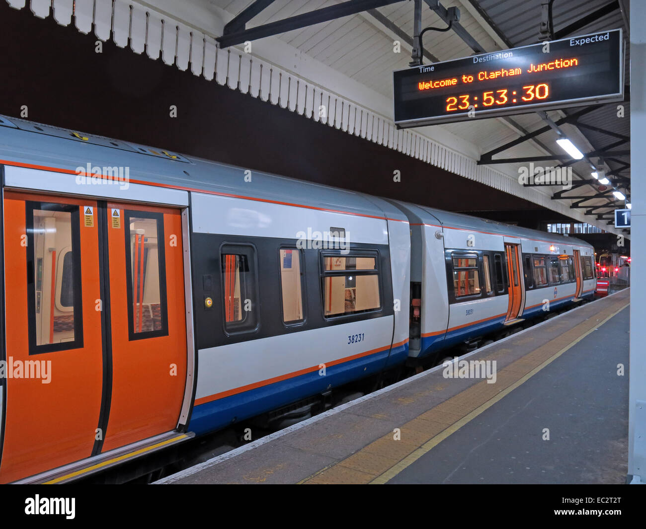 Great,Britain,GB,United,Kingdom,railways,train,overground,dusk,Battersea,south,night,Londons busiest,England,UK,platform,empty,doors,closed,dark,nearly,midnight,nighttime,transport,underground,fear,danger,of,travelling,at,safety,on,public,GoTonySmith,Buy Pictures of,Buy Images Of