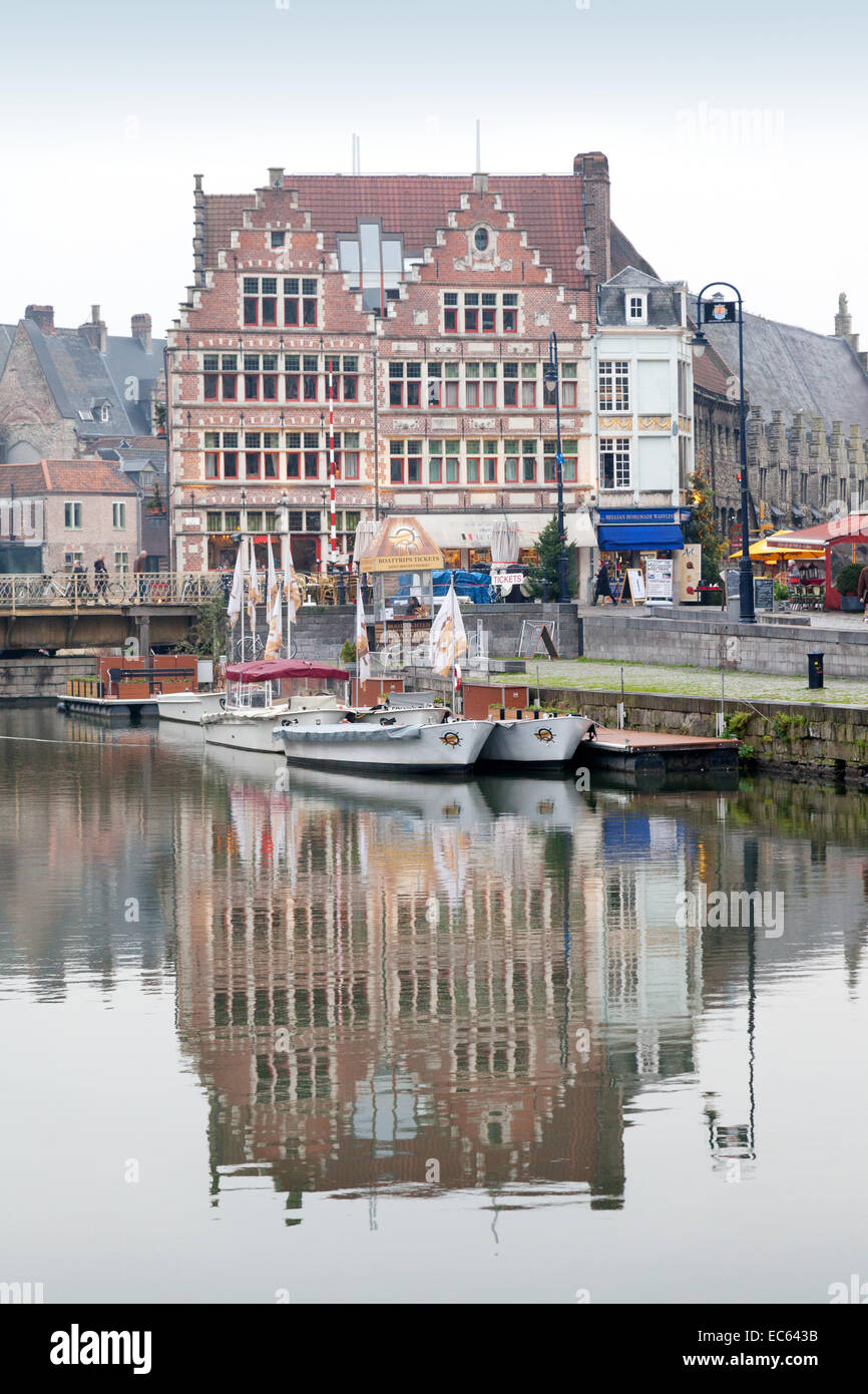 traditional-building-and-its-reflection-in-the-river-leie-in-winter-EC643B.jpg