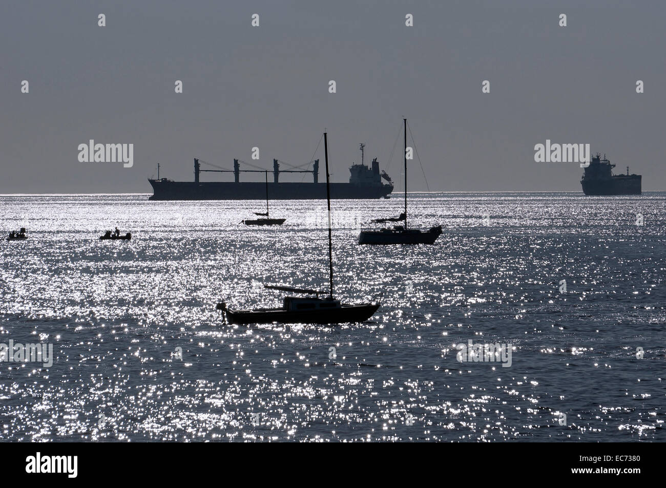 freighters-and-sailboats-at-anchor-in-en