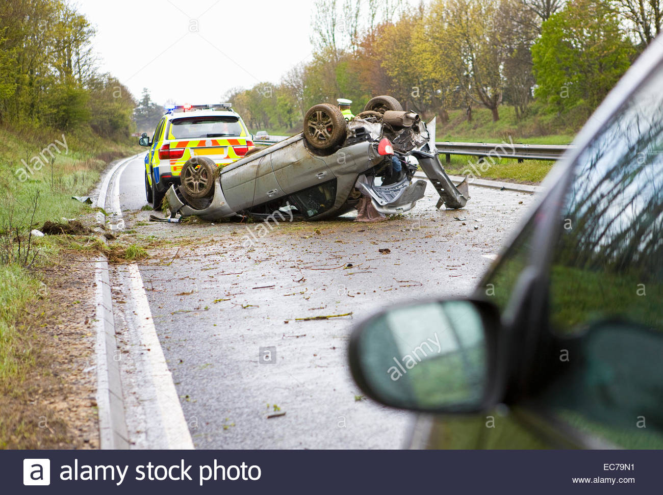 Crashed car on motorway - Stock Image