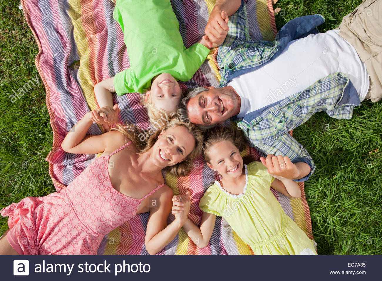 Overhead portrait of a multi generation family lying on the grass - Stock Image
