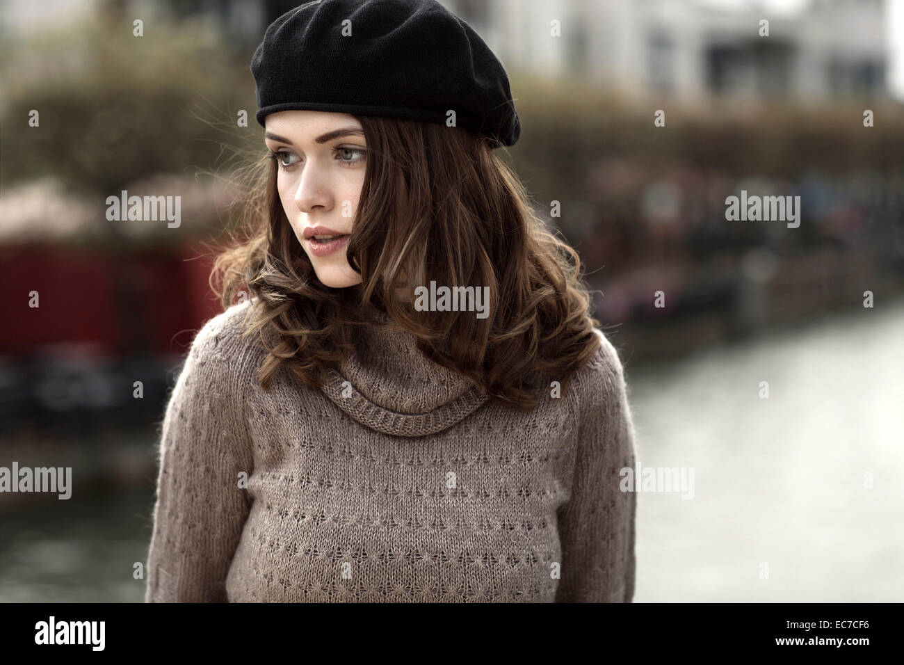 Portrait of young woman wearing beret and knitted dress Stock Photo ... df8e4d21786