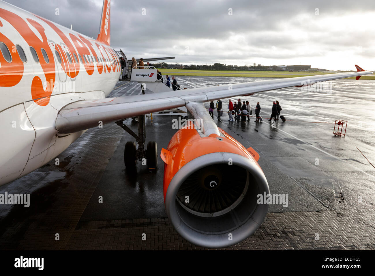 passengers boarding easyjet airbus aircraft at belfast international airport - Stock Image