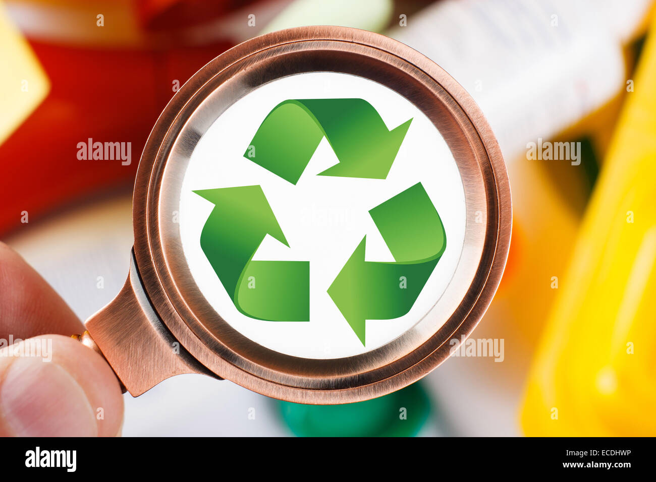 Men looking for a recycling symbol on plastic garbage - Stock Image