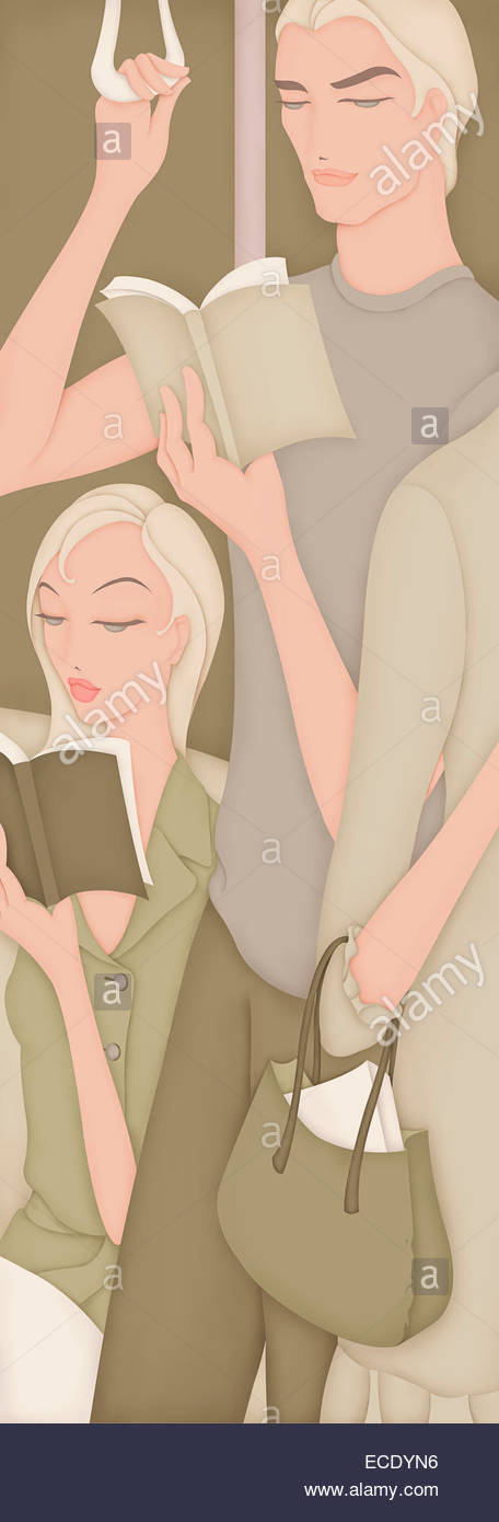 Commuters reading books on train - Stock Image
