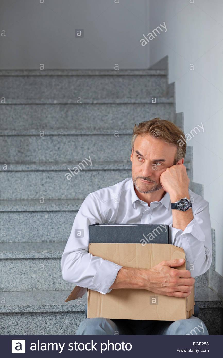 Businessman scandal shame depressed dept desperate - Stock Image