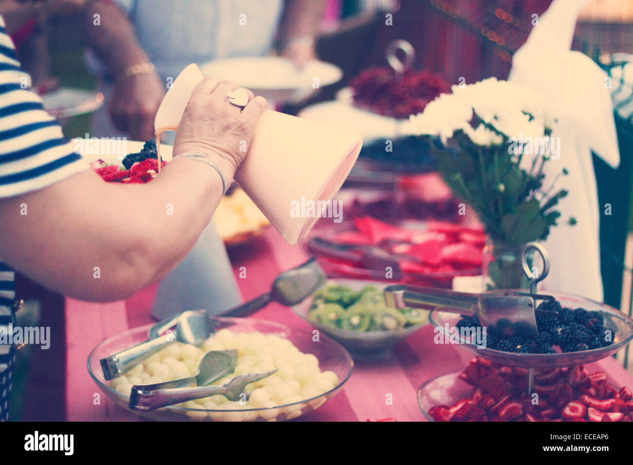 Woman eating at party - Stock Image