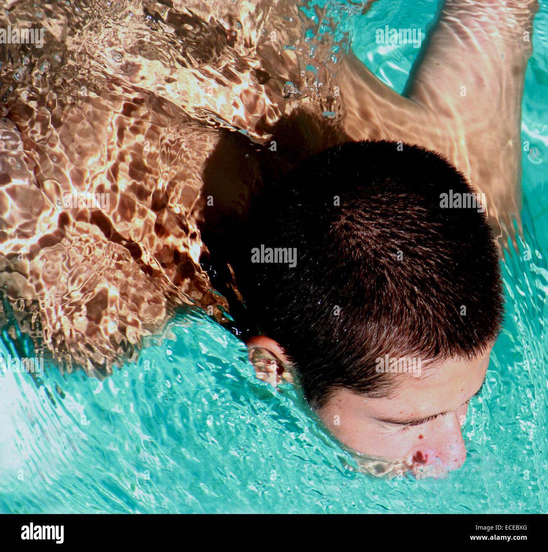 High angle view of swimming teenage boy - Stock Image