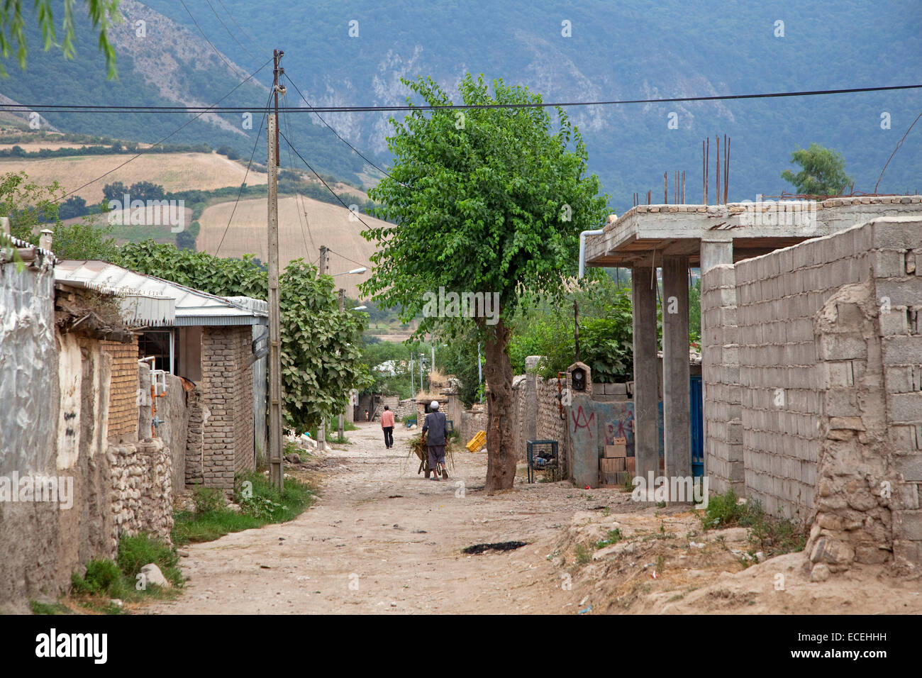 Houses along alley in a small village in rural Iran - Stock Image