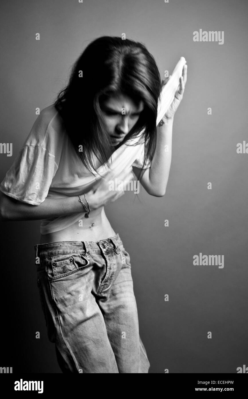 young woman undress stock photo: 76538641 - alamy