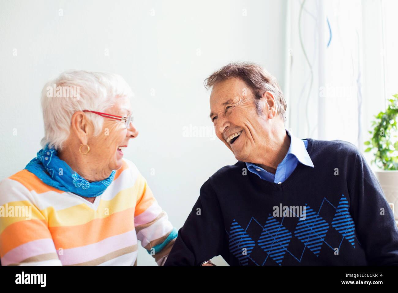 Happy senior couple spending leisure time at nursing home - Stock Image