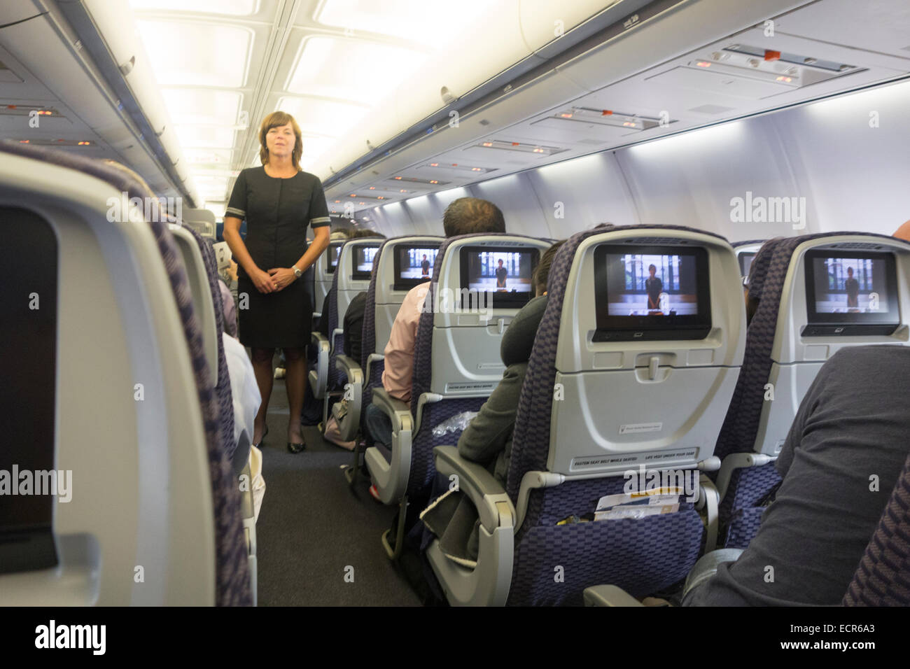 passengers on United Airlines airplane JFK airport Stock Photo