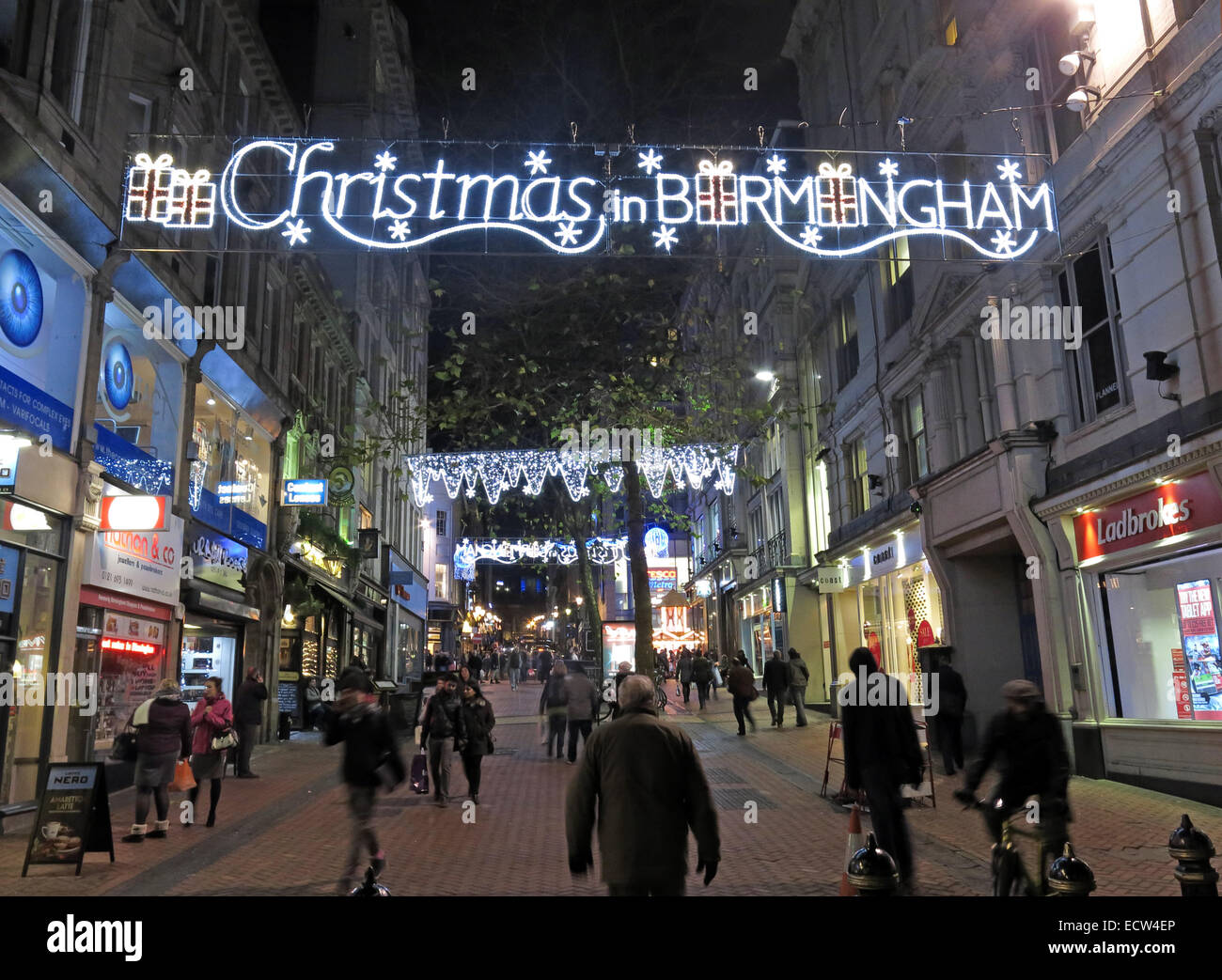 Christmas in Birmingham,Xmas,Brirmingham,shopper,shoppers,among,many,people,shopping,retail,busy,spend,spending,street,lane,st,New St,New Street,Christmas,night,dusk,winter,festival,Lights,light,decorations,in,Birmingham,West,Midlands,England,UK,United Kingdom,GB,multiracial,city,town,cities,gotonysmith,German market,German market,Frankfurt,centre,city centre,night,dusk,nighttime