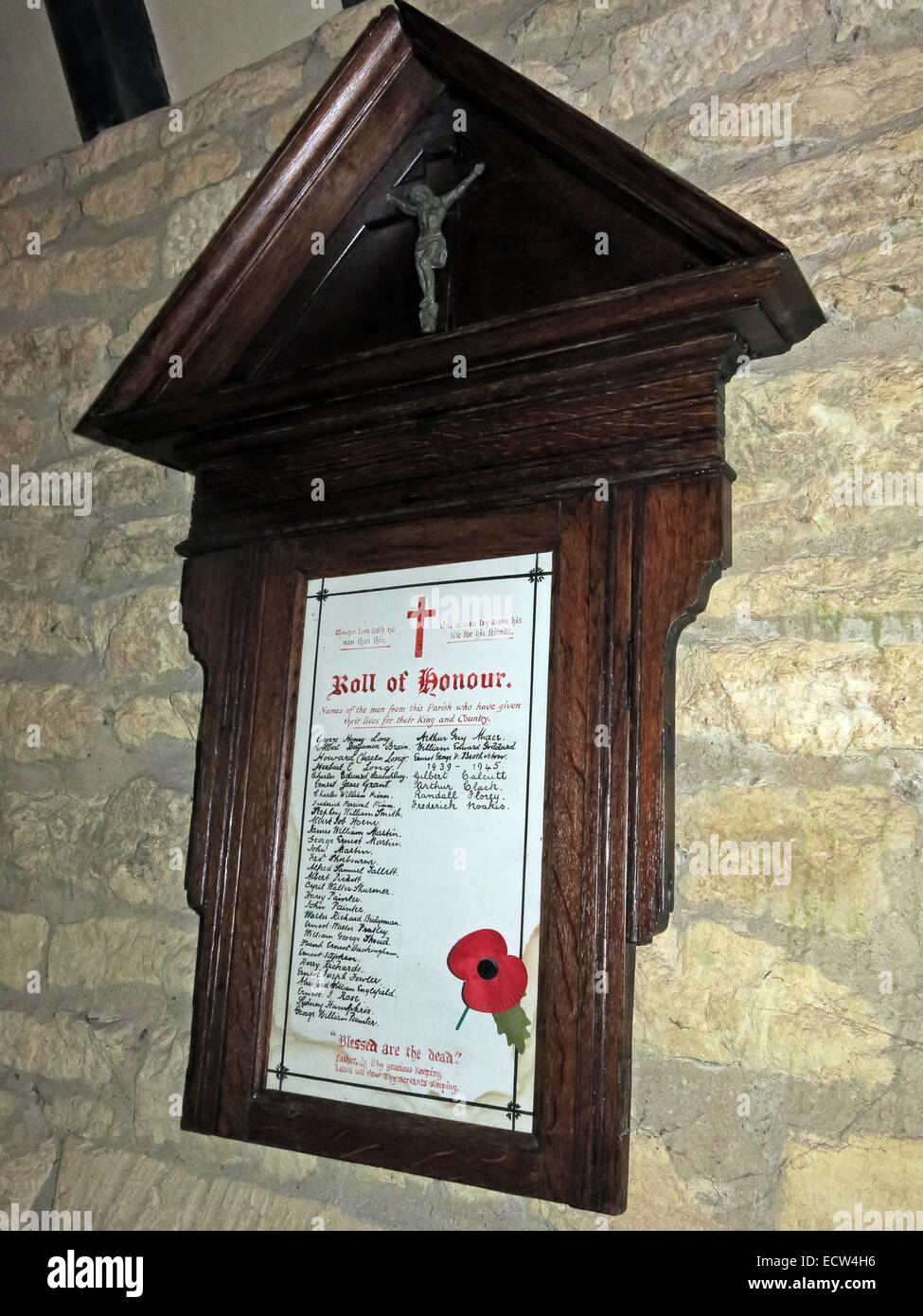 Wood,Green,United,Kingdom,with,a,poppy,November,wwI,WWII,world,war,list,of,names,of,the,fallen,wooden,memorial,and,crucifix,cross,crucified,christ,rememberance,West Oxfordshire,England,UK english curches historic,GotonySmith,list,of,soldiers,volunteers,neo-Gothic,neoGothic
