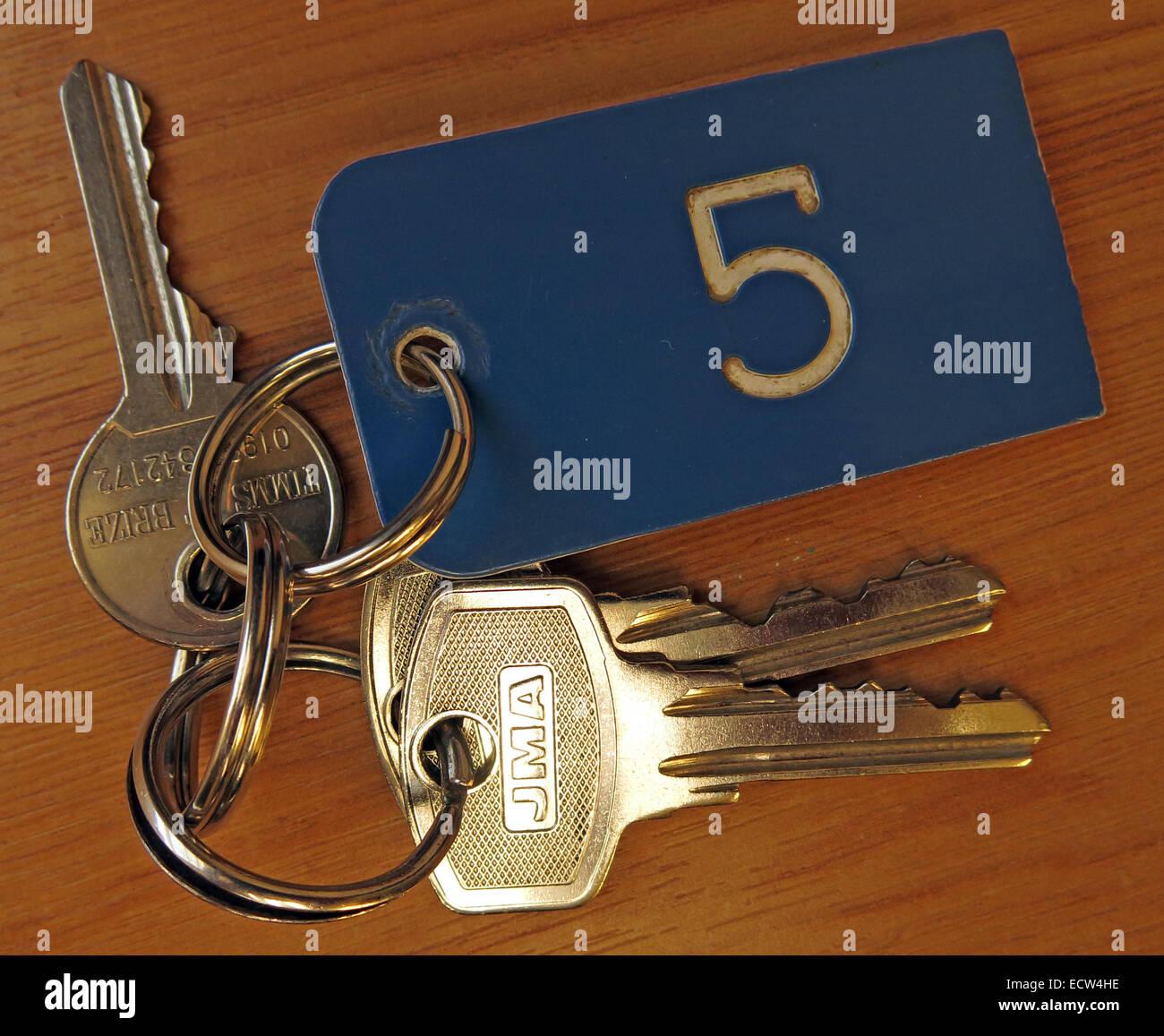 Five,key,keyring,on,a,table,three,metal,hotel,room,rooms,vacation,B&B,GoTonySmith
