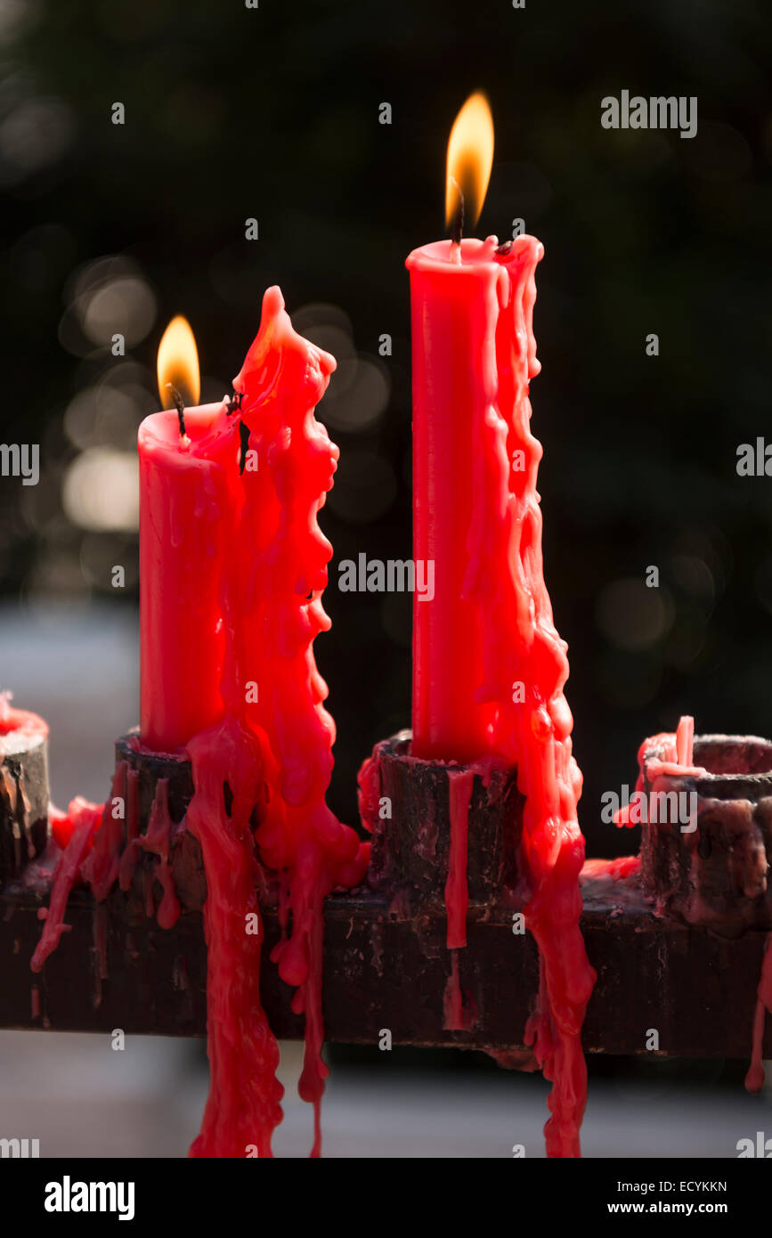 Burning red candles at Giant Wild Goose Pagoda Buddhist temple in Xi'an, China - Stock Image