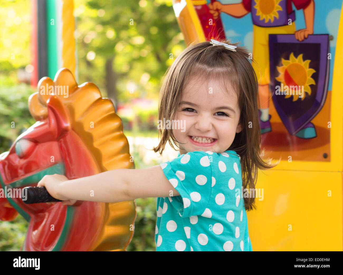 Little girl having fun in park - Stock Image